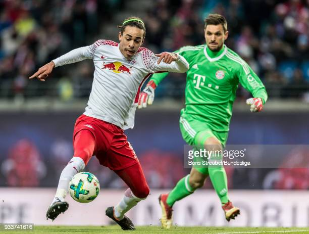 Yussuf Poulsen of RB Leipzig in action with goalkeeper Sven Ulrich of FC Bayern Muenchen during the Bundesliga match between RB Leipzig and FC Bayern...
