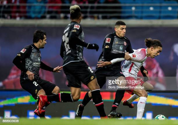 Yussuf Poulsen of RB Leipzig in action with JeanPhilippe Gbamin Leon Balogun and Giulio Donati of 1 FSV Mainz 05 during the Bundesliga match between...