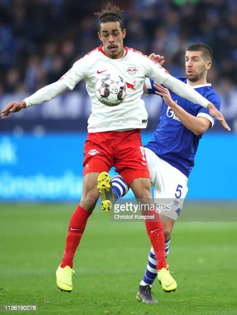 Yussuf Poulsen of RB Leipzig is challenged by Matija Nastasic of FC Schalke shoots during the Bundesliga match between FC Schalke 04 and RB Leipzig...