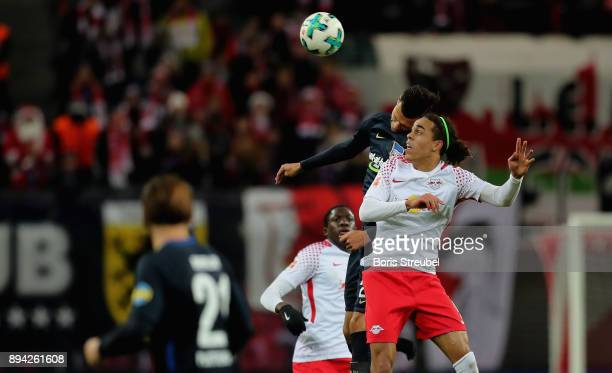 Yussuf Poulsen of RB Leipzig jumps for a header with Davie Selke of Hertha BSC during the Bundesliga match between RB Leipzig and Hertha BSC at Red...