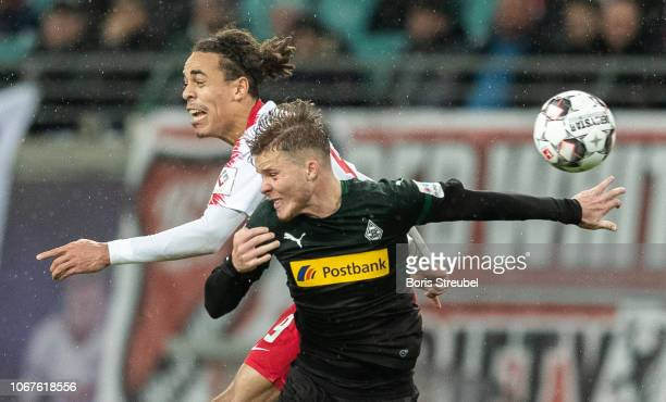 Yussuf Poulsen of RB Leipzig jumps for a header with Nico Elvedi of Borussia Moenchengladbach during the Bundesliga match between RB Leipzig and...
