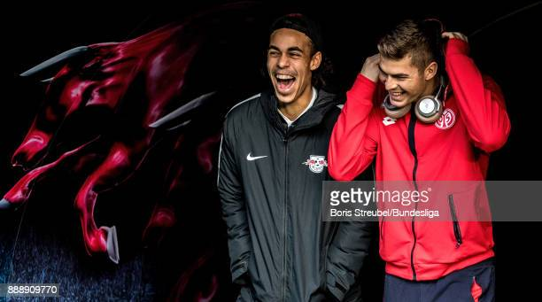 Yussuf Poulsen of RB Leipzig laughs with Emil Berggreen of 1 FSV Mainz 05 prior to the Bundesliga match between RB Leipzig and 1 FSV Mainz 05 at Red...