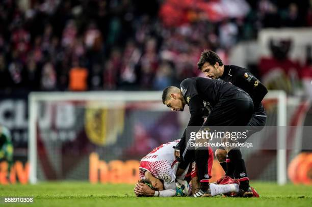 Yussuf Poulsen of RB Leipzig lies on the pitch during the Bundesliga match between RB Leipzig and 1 FSV Mainz 05 at Red Bull Arena on December 9 2017...