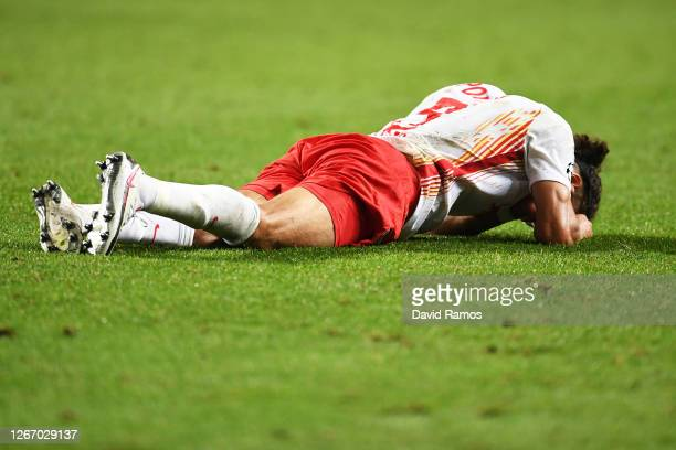 Yussuf Poulsen of RB Leipzig reacts to defeat after the UEFA Champions League Semi Final match between RB Leipzig and Paris Saint-Germain F.C at...