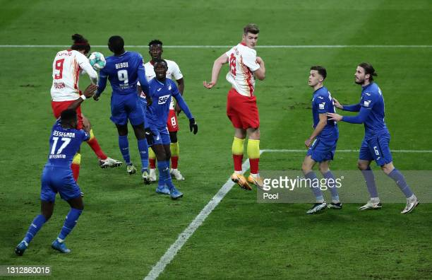 Yussuf Poulsen of RB Leipzig scores a goal which was later disallowed for a handball following a VAR review during the Bundesliga match between RB...