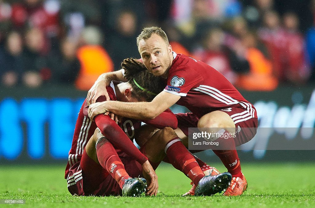 Yussuf Yurary Poulsen and Lars Jacobsen of Denmark looks dejected after the UEFA EURO 2016 Qualifier: Play-Off Second Leg match between Denmark and Sweden at Telia Parken Stadium on November 17, 2015 in Copenhagen, Denmark.