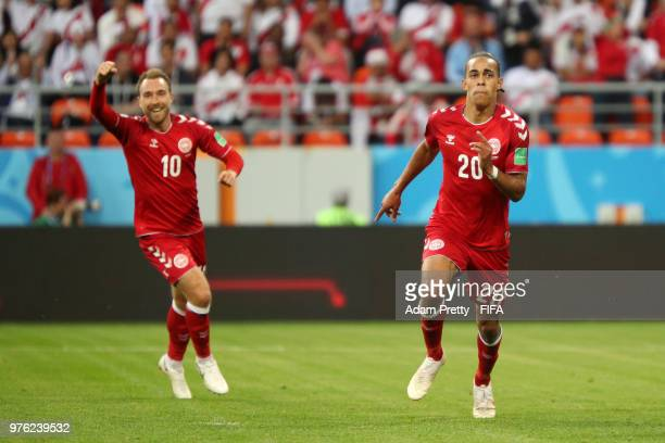 Yussuf Yurary Poulsen of Denmak celebrates after scoring his team's first goal with team mate Christian Eriksen during the 2018 FIFA World Cup Russia...