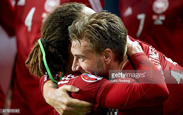 Yussuf Yurary Poulsen of Denmark celebrates with team mate Nicklas Bendtner after scoring their first goal during the UEFA EURO 2016 Qualifier match...