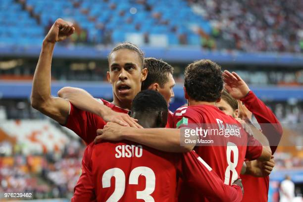 Yussuf Yurary Poulsen of Denmark celebrates with teammates after scoring his team's first goal during the 2018 FIFA World Cup Russia group C match...
