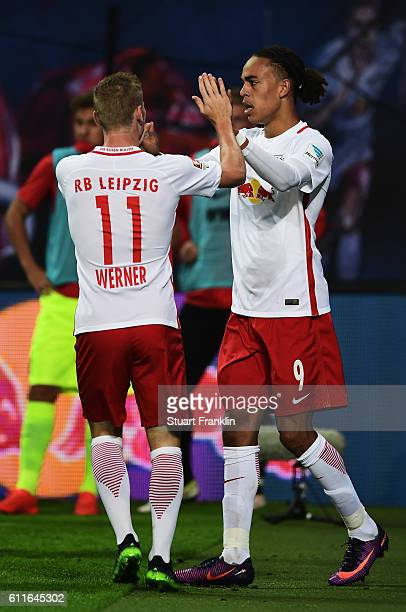 Yussuf Yurary Poulsen of Leipzig celebrates scoring his goal with Timo Werner during the Bundesliga match between RB Leipzig and FC Augsburg at Red...