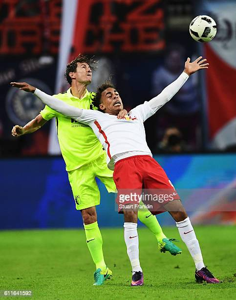 Yussuf Yurary Poulsen of Leipzig is challenged by Paul Verhaegh of Augsburg during the Bundesliga match between RB Leipzig and FC Augsburg at Red...