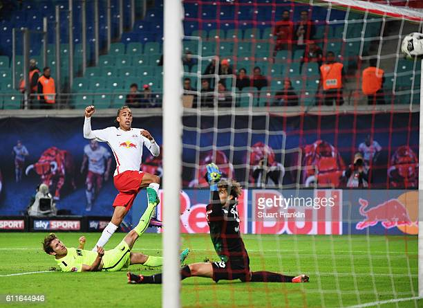 Yussuf Yurary Poulsen of Leipzig scores his goal during the Bundesliga match between RB Leipzig and FC Augsburg at Red Bull Arena on September 30...