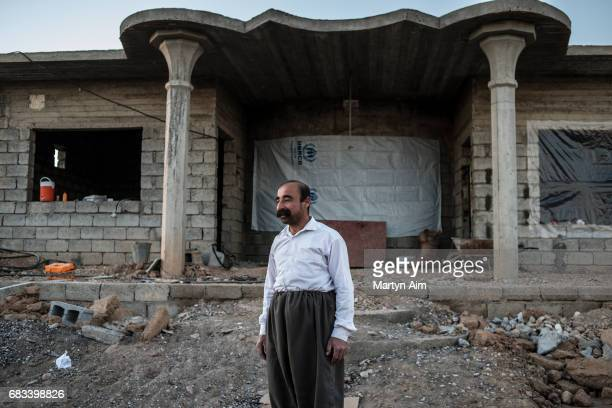 Yusuf 46 years old is Kaka'i an ethnic and religious minority in Iraq He stands in front of his damaged home in TalLaban village in the Nineveh...