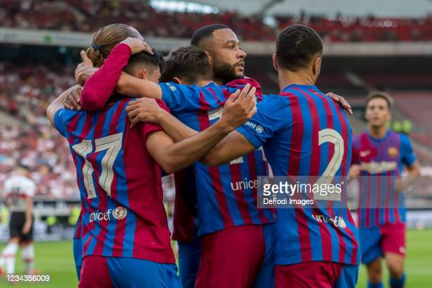 Yusuf Demir of FC Barcelona celebrates after scoring his team's second goal with teammates during the Pre-Season Friendly match between VfB Stuttgart...