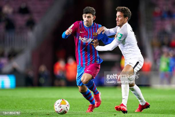 Yusuf Demir of FC Barcelona competes for the ball with Luis Milla of Granada CF during the La Liga Santander match between FC Barcelona and Granada...