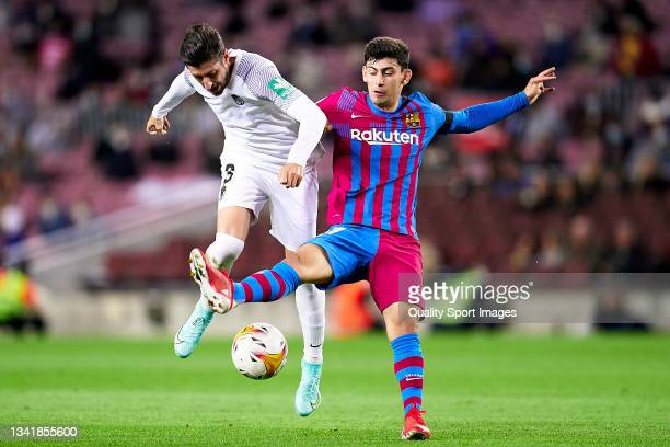 Yusuf Demir of FC Barcelona competes for the ball with Sergio Escudero of Granada CF during the La Liga Santander match between FC Barcelona and...
