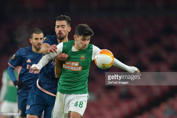 Yusuf Demir of Rapid Vienna and Pablo Marí of Arsenal battle for the ball during the UEFA Europa League Group B stage match between Arsenal FC and...