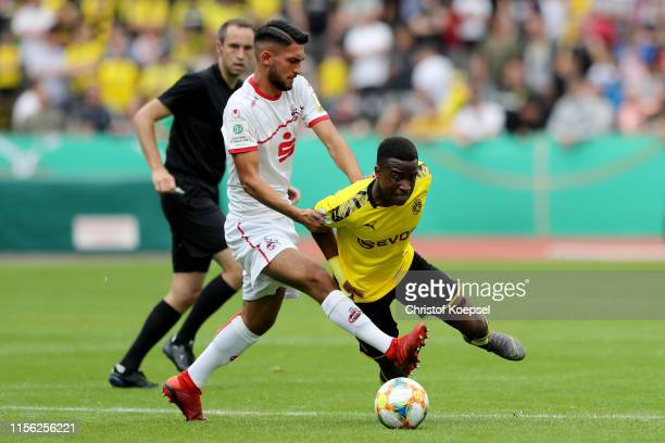 Yusuf Sahin Oernek of Koeln challenges Youssoufa Moukoko of Dortmund during the B-Juniors Bundesliga Final match between Borussia Dortmund and 1. FC...