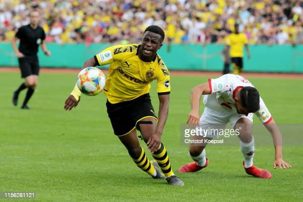 Yusuf Sahin Oernek of Koeln fouls Youssoufa Moukoko of Dortmund in the penalty area during the B-Juniors Bundesliga Final match between Borussia...