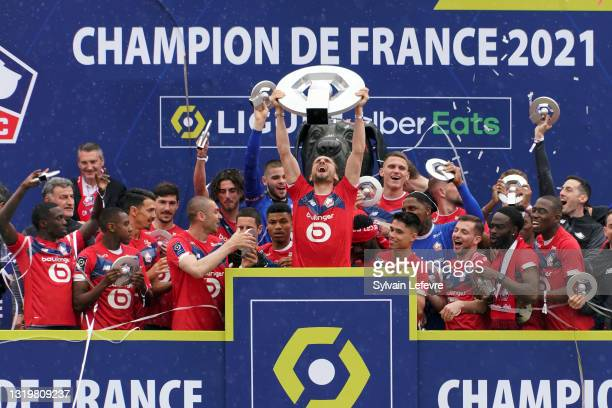 Yusuf Yazici and players of Lille OSC celebrate winning League 1 by receiving the trophy at their Luchin training center on May 24, 2021 in Lille,...