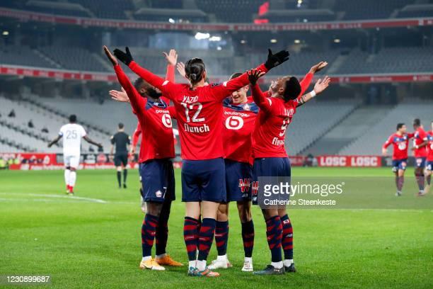 Yusuf Yazici of Lille OSC celebrates his goal with Jonathan Bamba, Domagoj Bradaric and Jonathan Christian David of Lille OSC during the Ligue 1...