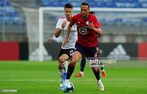 Yusuf Yazici of LOSC Lille with Julian Weigl of SL Benfica in action during the Pre-Season Friendly match between SL Benfica and Lille at Estadio...