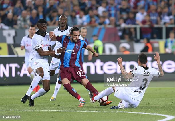 Yusuf Yazici of Trabzonspor in action against Adriano and Nicolas Isimat during Turkish Super Lig soccer match between Trabzonspor and Besiktas at...