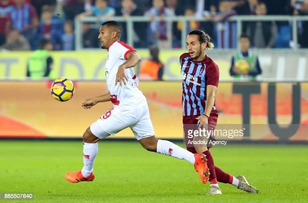 Yusuf Yazici of Trabzonspor in action against William Vainqueur of Antalyaspor during a Turkish Super Lig match between Trabzonspor and Antalyaspor...