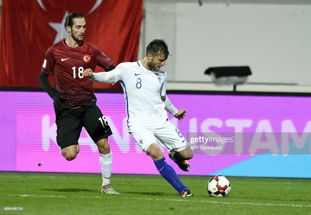Yusuf Yazici (L) of Turkey and Perparim Hetemaj of Finland vie for the ball during the FIFA World Cup 2018 qualifying football match between Finland and Turkey in Turku, Southern Finland on October 9, 2017. / AFP PHOTO / Lehtikuva / Antti Aimo-Koivisto / Finland OUT