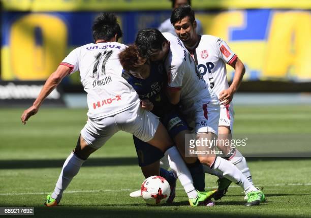 Yusuke Goto of Oita Trinita competes for the ball against Park Hyung Jin , Shohei Takeda and Kazuhito Watanabe of Fagiano Okayama during the J.League...
