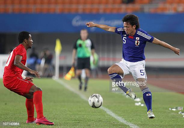 Yusuke Higa of Japan competes against Amer Abdulrahman alHammadi of United Abra Emirates at the men's football gold medal match during the 16th Asian...