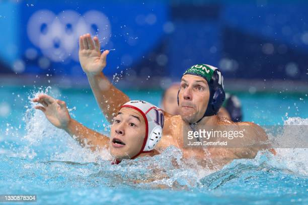 Yusuke Inaba of Team Japan and Denes Varga of Team Hungary compete during the Men's Preliminary Round Group A match between Japan and Hungary on day...