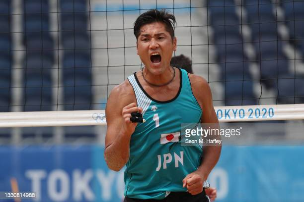 Yusuke Ishijima of Team Japan celebrates against Team Italy during the Men's Preliminary - Pool F beach volleyball on day four of the Tokyo 2020...