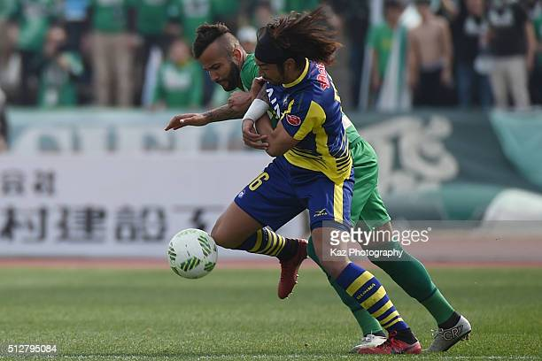Yusuke Kawagishi of Thespa Kusatsu Gunma and Evandro of FC Gifu compete for the ball during the JLeague second division match between Thespa Kusatsu...