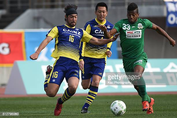 Yusuke Kawagishi of Thespa Kusatsu Gunma and Leomineiro of FC Gifu compete for the ball during the JLeague second division match between Thespa...