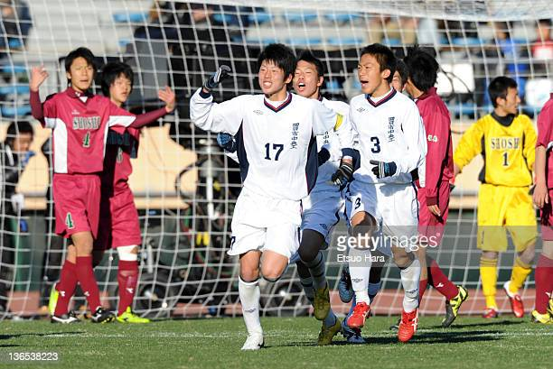 Yusuke Kuniyoshi of Yokkaichi Chuo Technical celebrates the first goal during the 90th All Japan High School Soccer Championship Semi Final match...