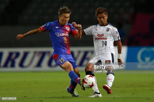 Yusuke Maruhashi of Cerezo Osaka and Kensuke Nagai of FC Tokyo compete for the ball during the JLeague J1 match between FC Tokyo and Cerezo Osaka at...
