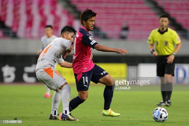 Yusuke Maruhashi of Cerezo Osaka controls the ball under pressure of Takashi Kanai of Shimizu S-Pulse during the J.League Meiji Yasuda J1 match...