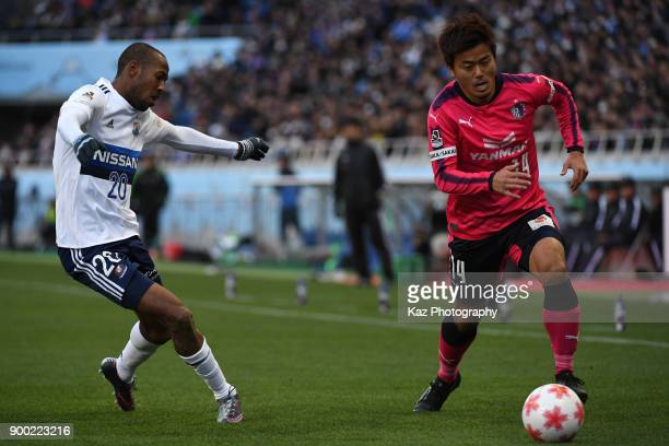 Yusuke Maruhashi of Cerezo Osaka dribbles the ball under the pressure from Martinus of Yokohama FMarinos during the 97th All Japan Football...
