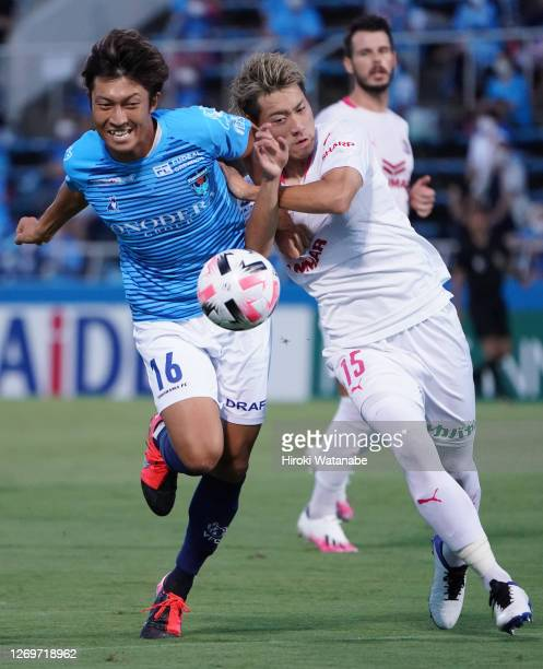 Yusuke Minagawa of Yokohama FC and Ayumu Seko of Celezo Osaka compete for the ball during the J.League Meiji Yasuda J1 match between Yokohama FC and...