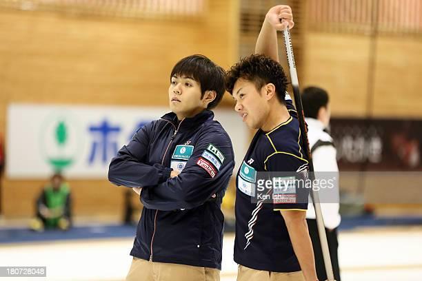 Yusuke Morozumi and Tsuyoshi Yamaguchi of SC Karuizawa look on during Game Three of the Curling Japan Qualifying Tournament between SC Karuizawa and...