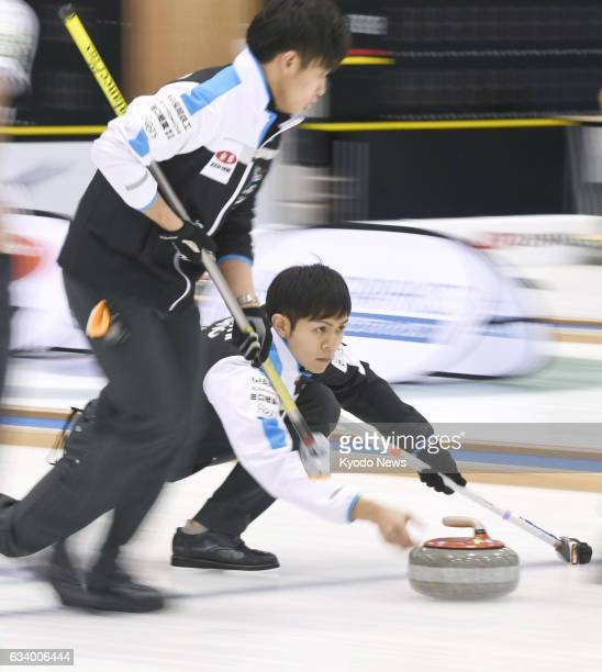Yusuke Morozumi makes a shot in the fifth end of SC Karuizawa Club's 105 win over Sapporo in the men's final of the national curling championships at...
