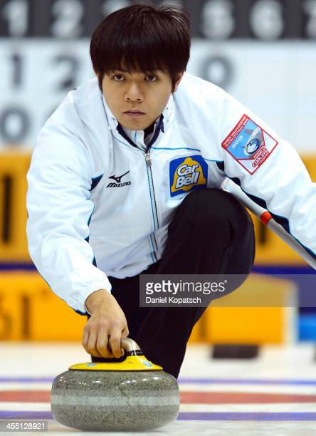 Yusuke Morozumi of Japan throws a rock during the Olympic Qualification Tournament match between Japan and Italy on December 11 2013 in Fussen Germany