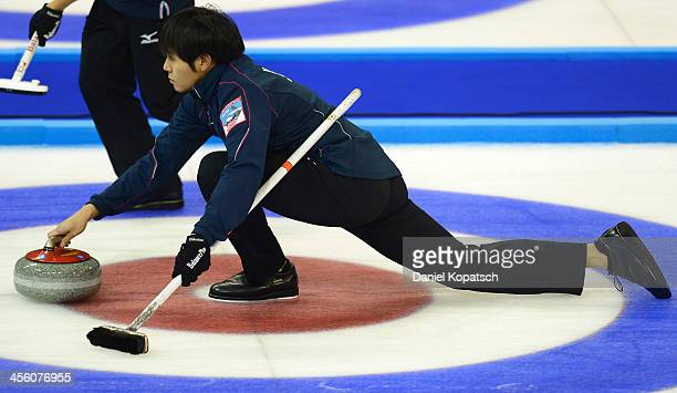 Yusuke Morozumi of Japan throws a rock during the Olympic Qualification Tournament match between Japan and Germany on December 13 2013 in Fussen...