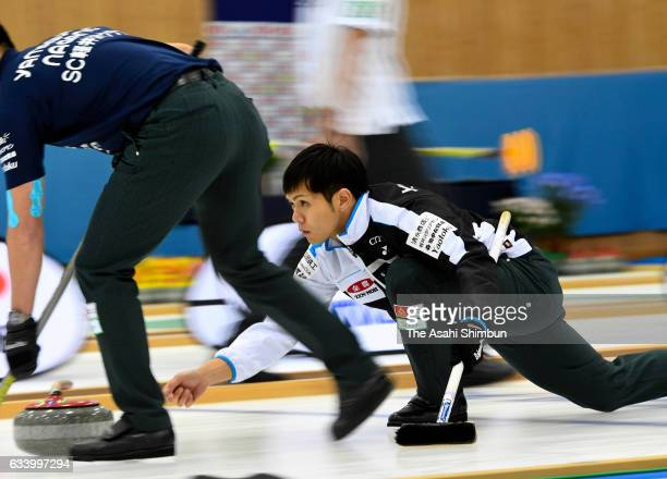 Yusuke Morozumi of SC Karuizawa deivers the stone in the 5th end in the Men's final during day seven of the 34th All Japan Curling Championships at...