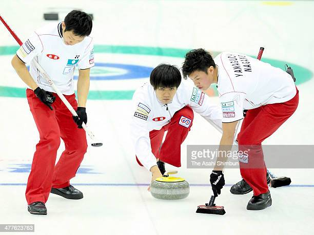 Yusuke Morozumi of SC Karuizawa delivers the stone during the 31st All Japan Curling Championships at Karuizawa Ice Park on March 9 2014 in Karuizawa...