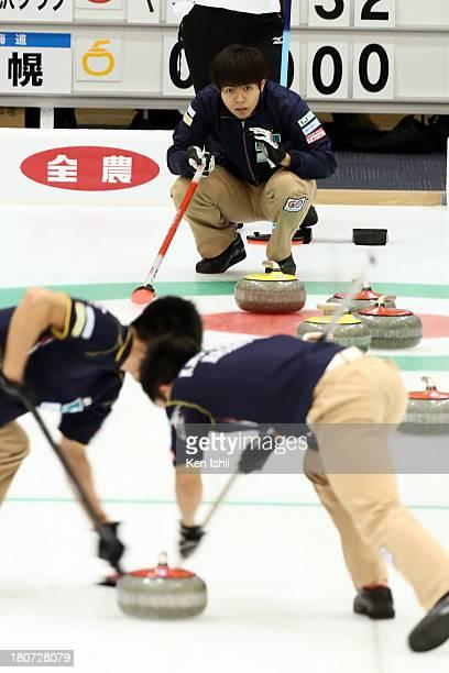 Yusuke Morozumi of SC Karuizawa instructs teammates during Game Three of the Curling Japan Qualifying Tournament between SC Karuizawa and Sapporo at...