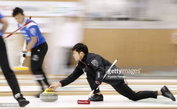 Yusuke Morozumi of SC Karuizawa plays a stone during the third end of the men's final of the Karuizawa International Curling Championships in...