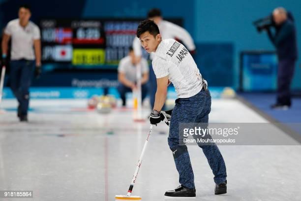 Yusuke Morozumi Tsuyoshi Yamaguchi and Kosuke Morozumi of Japan compete in the Curling Men's Round Robin Session 1 held at Gangneung Curling Centre...