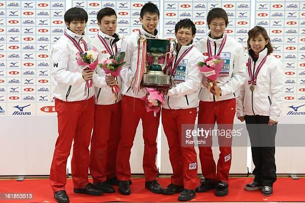 Yusuke Morozumi Tsuyoshi Yamaguchi Tetsurou Shimizu Kousuke Morozumi Yoshihiro Shimizu and coach Hatomi Nagaoka of SC Karuizawa Club pose with their...